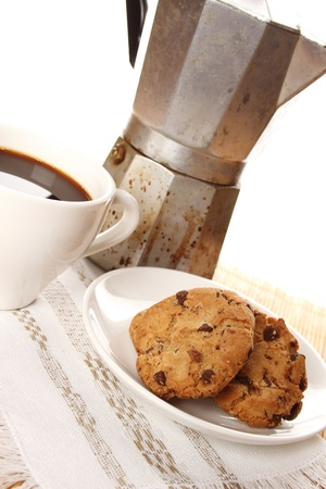 Close-up of round chocolate biscuits and a cup of coffee photo