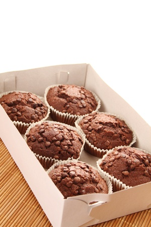 Close-up of a lot of chocolate muffins  isolated photo