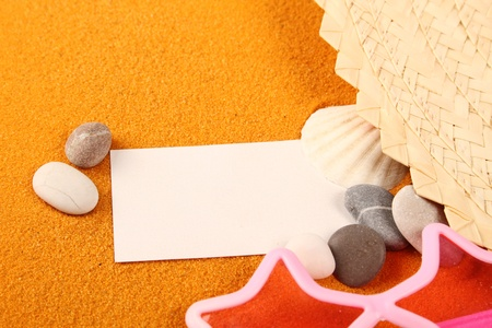 Close up on yellow sand paper and shell photo