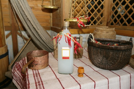 condensation basket: Slavic interior with a bottle of homemade alcohol