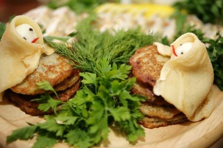 Close-up potato pancakes with fresh herbs  Russia photo