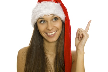 Smiling christmas santa woman pointing up. Isolated Stock Photo - 20930762