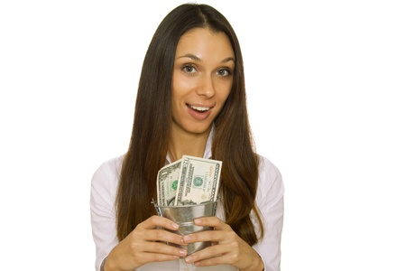 Business woman holding an iron bucket with dollars. Isolation photo