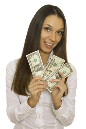 Attractive business woman holding dollars. Isolated photo