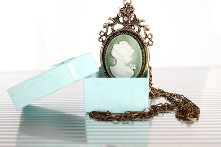 Close-up of vintage pendant in gift box Stock Photo