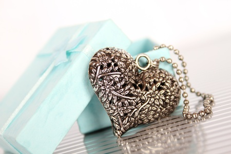Close-up of a heart necklace in a gift box photo