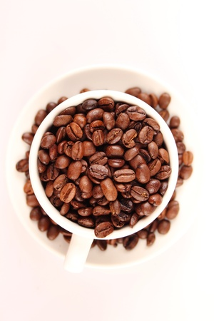 Close-up of white cup of coffee beans photo