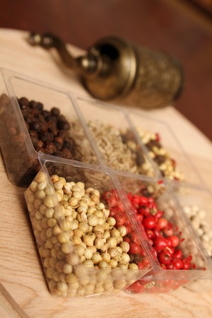 Close-up of six species of spices and Mill photo