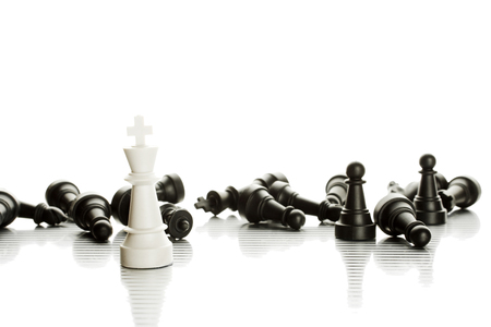 An army of black and white chess pieces. Isolate Standard-Bild