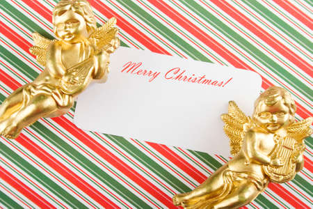 Close-up Christmas card  Paper, angels, holiday greetings photo