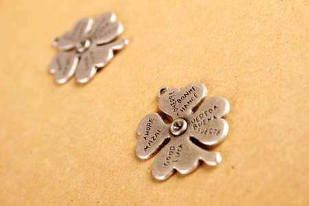 saint patty's: Closeup metal clover  that says a lot of desires Stock Photo