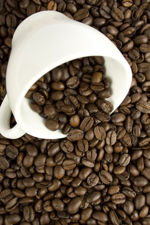 untidiness: Against the backdrop of overturned white coffee beans from the cup and spilling coffee beans