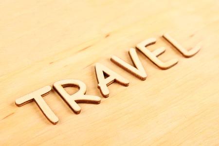 hape: Closeup on wooden text  Travel