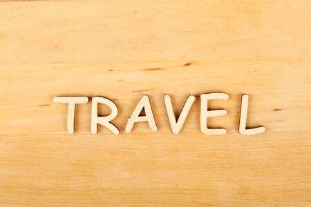 hape: Closeup on wooden background wooden text Travel Stock Photo