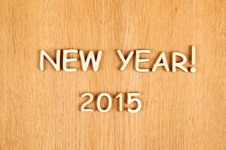 Closeup wooden text  New year 2015   Background photo
