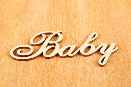 Closeup wooden words Baby on a wooden background photo
