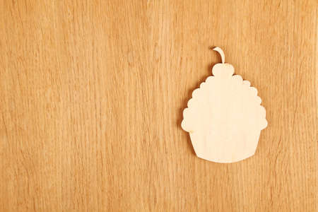 On a wooden background wooden silhouette cake. menu photo