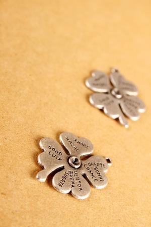saint patty's: Closeup metal clover. that says a lot of desires