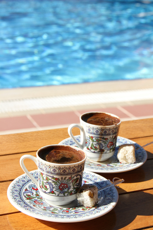 turkish coffee: Traditional Turkish coffee is hot around the pool. Stock Photo