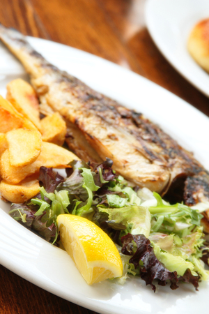 Grilled Dorado with vegetables on the terrace