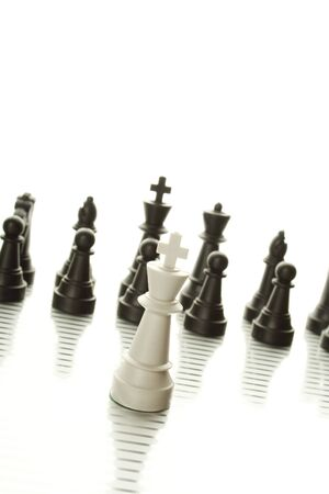 Chess pieces embody business strategy. Isolated on white background Stock Photo