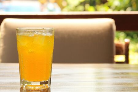 carbonation: A glass of fizzy drink on a wooden table Stock Photo