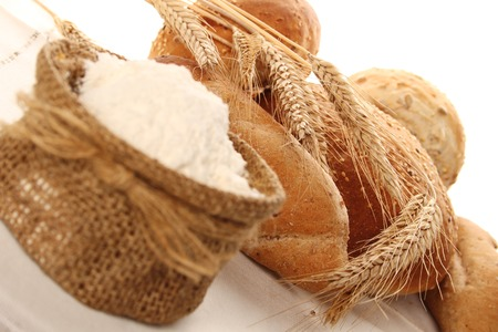 spica: Close-up of flour in a bag and different types of bread. Isolate