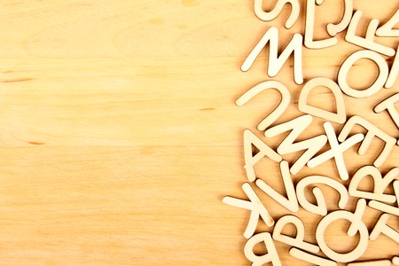Wooden letters and numbers laid out in a row