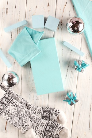 Holiday in tiffany color. Turquoise boxes, cloth and cubes for writing text. Flatlay