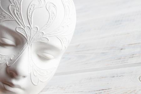 White mask with carnival patterns. Foto de archivo