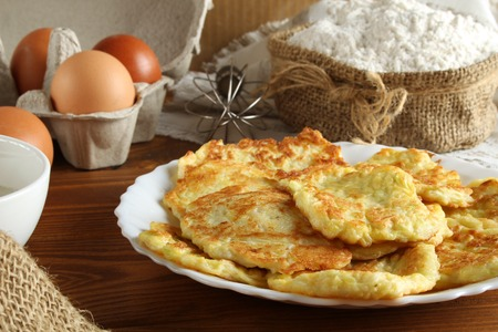 Pancakes from pumpkin. Healthy food, natural products: pumpkin, eggs flour sour cream Reklamní fotografie