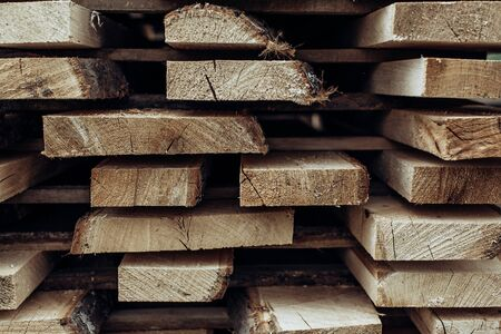 Piles of wooden boards in the sawmill, planking.