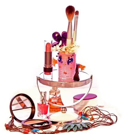 inanimate: composition of inanimate objects, cosmetics, powder, paint, female curlers several brushes, lipstick for applying makeup on the face