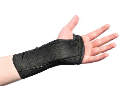 Arm Wrapped in a Black Wrist Brace Isolated on White Stock Photo
