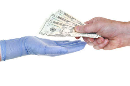 doctor money: Patient Giving Doctor Money Representing Rising Healthcare Costs Stock Photo