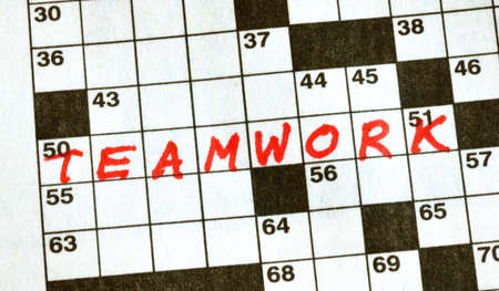 crossword puzzle: The Word Teamwork on Crossword Puzzle in Red Ink, Copy Space