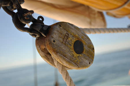 schooner: Old Wooden Block  Pulley  on Schooner Sailboat