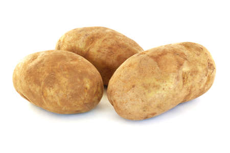 russet: Three Raw Russet Potatoes Isolated on White