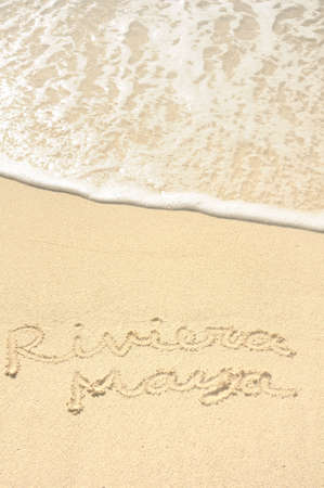 riviera maya: The Phrase Riviera Maya Written in the Sand on a Beach