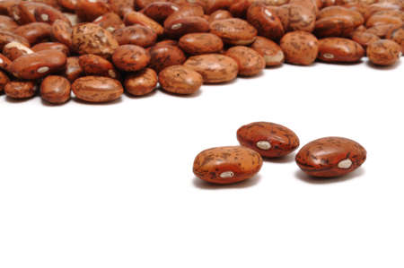 Three Pinto  Mottled  Beans Isolated On White With Many More In the Background photo