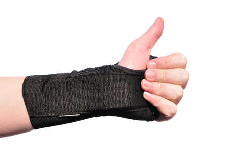 Arm Wrapped in a Black Wrist Brace Doing Thumbs Up Isolated on White Stock Photo - 13125201