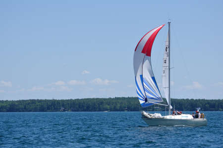 BAYFIELD, WI - July 4: Sailboat Sailing in Annual Bayfield Race Week Competition on Lake Superior on July 4, 2011 near Bayfield, Wisconsin Stock Photo - 13155010