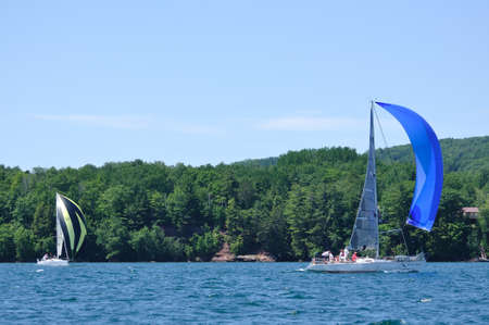 BAYFIELD, WI - July 4: Sailboat Sailing in Annual Bayfield Race Week Competition on Lake Superior on July 4, 2011 near Bayfield, Wisconsin Stock Photo - 13155013