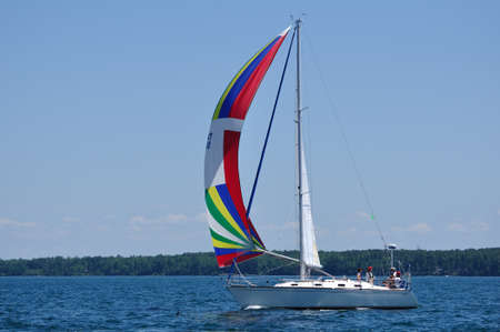 BAYFIELD, WI - July 4: Sailboat Sailing in Annual Bayfield Race Week Competition on Lake Superior on July 4, 2011 near Bayfield, Wisconsin Stock Photo - 13267064
