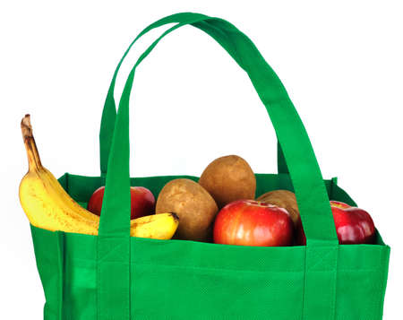 tote: Reusable Green Bag with Groceries Isolated on White Stock Photo