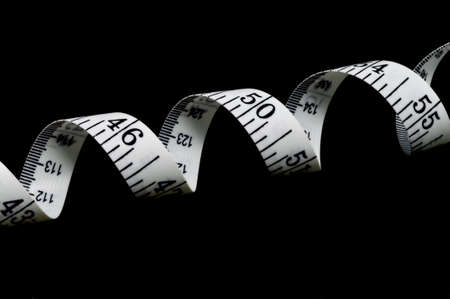 Tape measure isolated on a black background, horizontal Imagens - 14235826