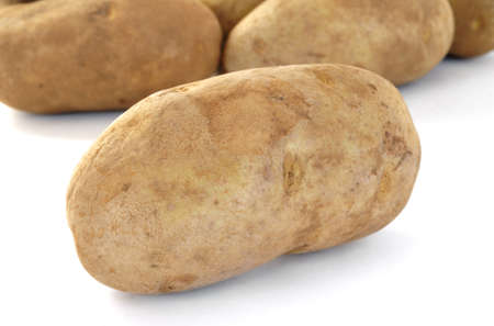 russet: Raw Russet Potatoes Isolated on White