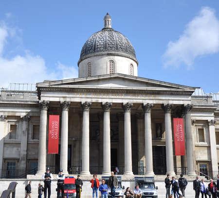 LONDON, ENGLAND - June 15: National Gallery in Trafalgar Square wtih Tourists on June 15, 2012 in London, England Redakční