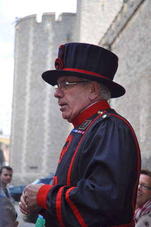 beefeater: LONDON, ENGLAND - June 17: Beefeater Giving a Tour at the Tower of London on June 17, 2012 in London, England