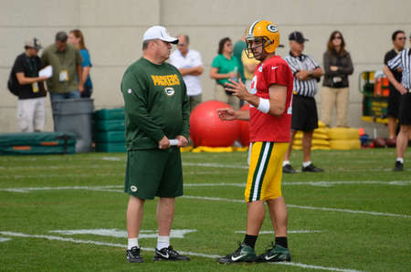 GREEN BAY, WI - AUGUST 19 : Green Bay Packers Quarterback Aaron Rodgers Talks with Head Coach Mike McCarthy During Training Camp Practice on August 19, 2012 in Green Bay, WI